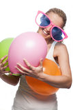Laughing woman preparing for a party Stock Photos