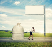 Laughing woman pulling big bag Royalty Free Stock Photography