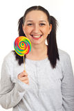 Laughing woman in pyjama with lollipop Stock Images
