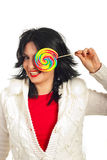 Laughing woman qith colorful lollipop Royalty Free Stock Images