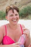 Laughing woman in red bikini Stock Photo