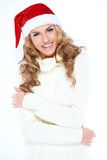 Laughing woman in a red Santa hat Stock Photo