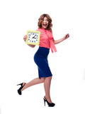 Laughing woman running with clock Royalty Free Stock Image