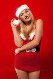Laughing woman in a Santa costume Stock Photography