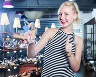 Laughing woman shopaholic holding desired shoe Stock Image