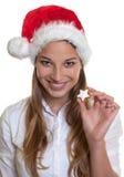 Laughing woman showing christmas cake Stock Image