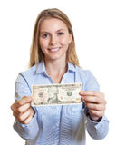 Laughing woman showing dollar note Royalty Free Stock Image