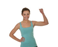 Laughing woman showing her muscles Stock Photography