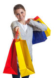 Laughing woman showing her shopping bags Royalty Free Stock Photography