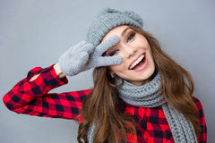 Laughing woman showing two fingers sign Royalty Free Stock Photos