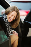 Laughing Woman Sitting in Car Stock Photography