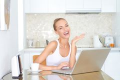 Laughing woman sitting at laptop computer Royalty Free Stock Photos