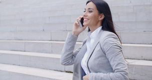 Laughing woman sitting on steps with phone Stock Photos