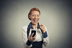 Laughing woman with smart phone Stock Photo