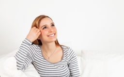 Laughing woman on a sofa Stock Photography