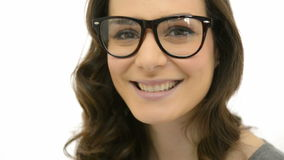 Laughing woman with spectacle. Closeup of smiling young woman wearing eyeglasses. Happy girl with spec isolated on white background. Portrait of beautiful woman stock video footage