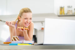 Laughing woman spread toast with chocolate cream Stock Photography