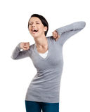 Laughing woman stretches herself Stock Photos