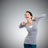 Laughing woman stretches herself Stock Photo