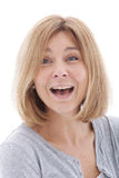 Laughing woman with a surprised expression Stock Image