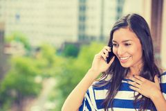 Laughing woman talking on mobile phone Stock Photo