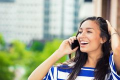 Laughing woman talking on mobile phone Royalty Free Stock Photo