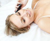 Laughing woman talking on phone lying on her bed Royalty Free Stock Photos