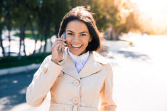 Laughing woman talking on the phone Royalty Free Stock Image