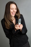Laughing Woman Texting royalty free stock images