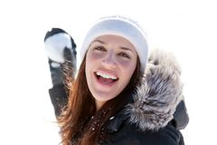 Laughing woman throwing snowball Stock Photos