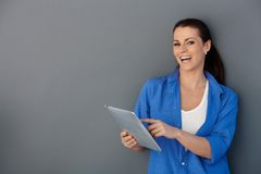 Laughing woman with touchscreen pad Royalty Free Stock Photography