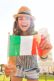 Laughing woman tourist holding Italian flag in Pisa Stock Image