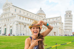 Laughing woman tourist making finger photo frame in Pisa Royalty Free Stock Photo