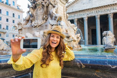 Laughing woman tourist taking photo at Pantheon fountain in Rome Royalty Free Stock Photography
