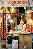Laughing woman vendor selling sausages in the Philippines royalty free stock photography