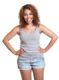 Laughing woman from Venezuela with hot pants Royalty Free Stock Image