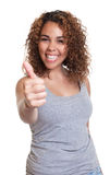 Laughing woman from Venezuela showing thumb Stock Images