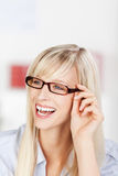 Laughing woman wearing glasses Stock Image