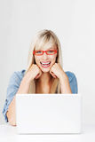 Laughing woman wearing red glasses Stock Photography