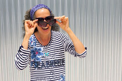 Free Laughing Woman Wearing Two Sunglasses Royalty Free Stock Image - 57371206
