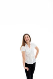 Laughing woman in a white blouse and dark jeans Royalty Free Stock Photography