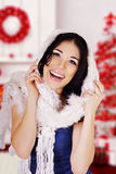 Laughing woman in white knitted scarf on red white winter background. Stock Images