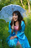 Laughing woman with white umbrella Stock Images