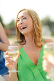 Laughing woman with wine glass Stock Images