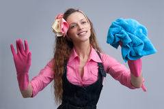 Laughing woman wiping with a blue rag Royalty Free Stock Image