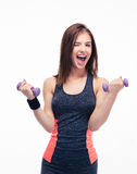 Laughing woman working out with dumbbells Stock Photos