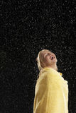 Laughing Woman Wrapped In Towel In Rain Royalty Free Stock Photos