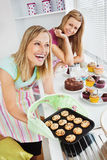 Laughing women baking together Royalty Free Stock Images