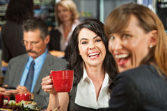 Laughing Women in Cafe Royalty Free Stock Images