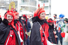 Laughing women at a carnival parade royalty free stock photography